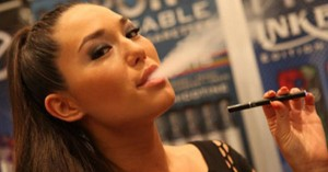 girl using electronic cigarette